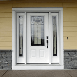 Smooth Fibreglass exterior door with two sidelites. Bellflower decorative glass. Professionally painted.