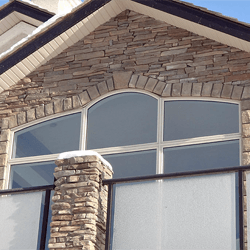 Custom shaped replacement windows on home.