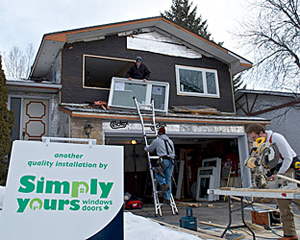 Simply Yours Windows and Doors installing a window